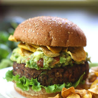 Smoky Black Bean Burgers with Guacamole and Plantain Chips.