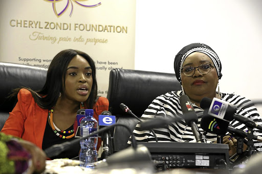 Cheryl Zondi is joined on stage by CRL chairperson Thoko Mkhwanazi-Xaluva during the launch of her foundation in Johannesburg yesterday. / Thulani Mbele