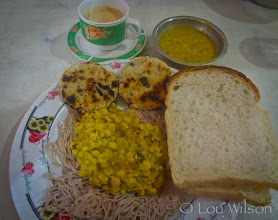 Photo: Lunch in Matara Sri Lanka $.85 Tea, 2 types of dhal, Stringhoppers, bread type of Wadi (Dhal Paddy) Notice the plate is wrapped in a fresh plastic wrap to show how clean it is.