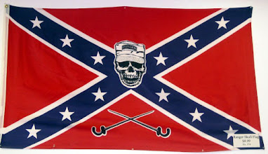 Photo: A redneck flag seen in a souvenir shop. What are those crossed things at bottom, exactly?