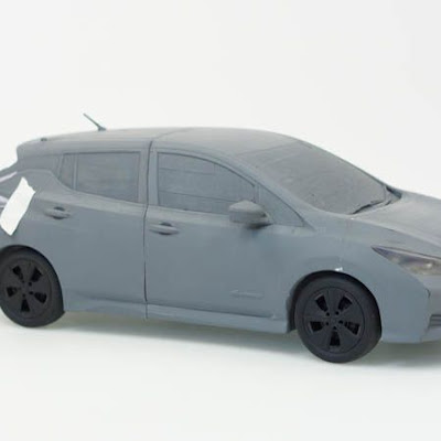 3d printing gallery image of a nissan leaf car, made in sla resin and painted gray