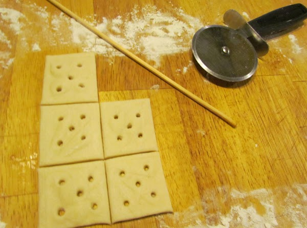 After your squares are cut poke holes in them using a wooden skewer (the...