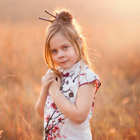 Serenity by Shayne Janks Nicolas - Babies & Children Child Portraits ( child, orange, little girl, red, grass, dress, sunset, south africa, blue eyes, flowers, africa, chinese )