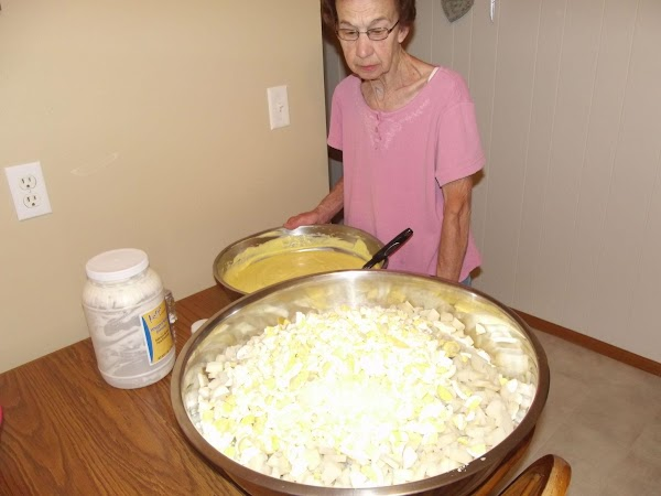 Pour dressing mixture over potato/egg/onion mixture. Put on food service gloves and use your...