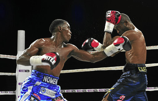 Xolisani Ndongeni (left), in action against Abraham Ngaendopa, stopped Salumi Jengo in Soweto on Saturday to retain his title.