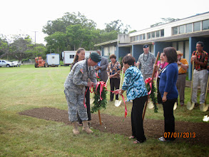 Photo: US Army Garrison Hawaii Commander Colonel Daniel Whitney and Principal Iwase untied the maile lei prior to the actual groundbreaking.