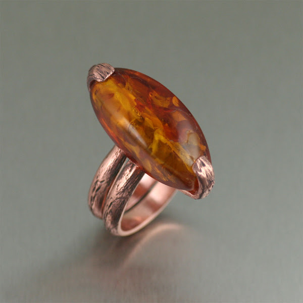 Photo: Earthy and chic, this tree branch design combined with the rich rose-gold look of copper is highlighted with a large honey Amber gemstone.
