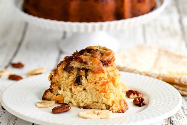 A Slice Of Caramel Pecan Banana Cake On A Plate.