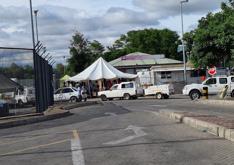 Cars and people travelling from Zimbabwe into South Africa at the Beitbridge border queue to have their Covid tests before being allowed entry into the country.