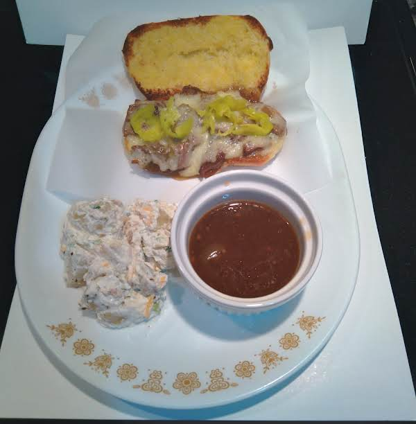 Steak And Cheese Sub Sandwich With Au Jus Dipping Sauce. And Side Of Your Choice