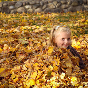 A Wink from the Leaves by Dallas Golden - Babies & Children Child Portraits ( fall leaves, girl )