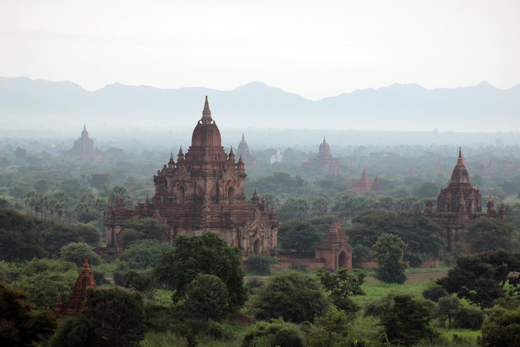 The mystical temples of Bagan, Myanmar, just before sunrise. See it on a river cruise.