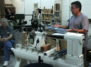 "Photo: Bert Bleckwenn looks on as Mark Sfirri begins his demo. Note the black cloth behind the lathe (from Mark) that he uses as a visual background to help him see the ""shadow"" better."