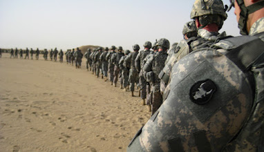 Photo: Soldiers from the 34th Red Bull Infantry Division walk onto a firing range outside of Camp Buehring, Kuwait, to check their weapon's sight in preparation for their movement to Basra, Iraq.