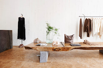 dao wood table on patchwork wood floor in the background white pins wall in pas de calais store in paris photo by Adrien Dirand