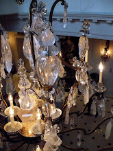 Photo: Looking past the chandelier to the entrance foyer below.