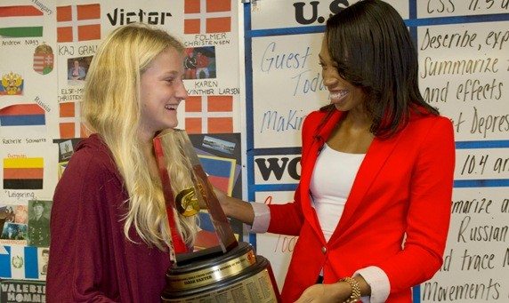 Sarah Baxter, left, of Simi Valley High School is surprised with the 2012-13 Gatorade National Girls Cross Country Runner of the Year trophy by Allyson Felix, Friday, Jan. 25, 2013 in Simi Valley, Calif. The award recognizes outstanding athletic excellence as well as high standards of academic achievement and exemplary character demonstrated on and off the field. Felix earned Gatorade National Girls Track and Field Athlete of the Year and Gatorade Female Athlete of the Year honors in 2003. Photo/Gatorade, Susan Goldman, handout.