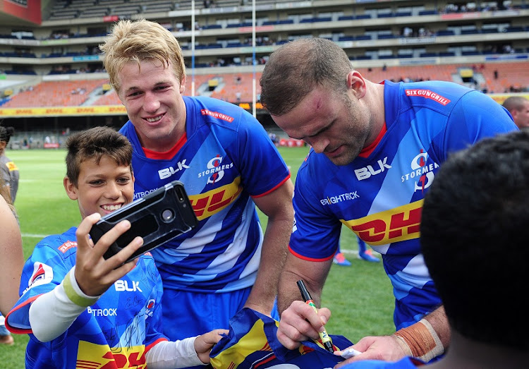 Pieter-Steph du Toit of the Stormers poses for a photograph with a young fan after the 2020 Super Rugby game between the Stormers and the Hurricanes at Newlands Rugby Stadium in Cape Town on 1 February 2020.