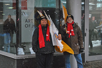 Photo: Members of the United Steelworkers (USW) stand with their flags, watching the marching crowd go by.