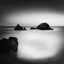 """Photo: """"Sutro Stacks"""" - http://www.createwithlightphotography.com  This is a 105 second exposure of the famous Sutro Sea Stacks in San Francisco, California.  I was in San Francisco for a conference in early May and had the opportunity to spend a wonderful evening with my good friends, +Nathan Wirth , +Steve-Maxx landeros , +Ivan Makarov and +Albert Tam . As the conditions weren't ideal for long exposure (read as zero clouds), way more time was spent that evening at the Cliff House restaurant chatting, which is really what these meet-ups are all about. I got to know these guys even better and it was awesome to get their perspective on photography, life and the universe. Thanks for sparing the time guys, I had such a great time.  Sutro is a magical place and understandably has been photographed so many times from every possible angle and under all weather and tidal conditions. Therefore, creating something unique is no easy task. I haven't seen this composition before, so hopefully it is a little different to the usual fare :-)  As +Olivier Du Tré knows, this is about as minimal as my photography gets. The lack of clouds really forced me to think even harder about how to make best use of the tones and composition to deliver something powerful, yet minimal...hopefully you like the results as much as I do :-)  The techie Stuff:  ISO: 100 Aperture: f/8 Exposure: 105 seconds Focal Length: 35mm Filters: Hitech Pro 10 stop ND filter, Lee 3and 2 stop soft grad ND filter  This is my contribution to the #MinimalMonday theme, kindly curated by +Olivier Du Tré , the #MonochromeMonday theme, kindly curated by +Charles Lupica , +Bill Wood , +Jerry Johnson and +Hans Berendsen , the #MoodyMonday theme curated by +Philip Daly , the #landscapephotography theme run by +Bill Wood , the #FineArtPls theme, curated by the lovely +Marina Chen and +FineArtPls , the #BWFineArt theme, curated by the amazing Mr +Joel Tjintjelaar and +Black and White Fine Art Photography Gallery , #SquaresAreSa"""