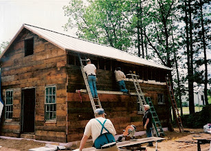 Photo: Sheathing the walls with our salvaged lumber.