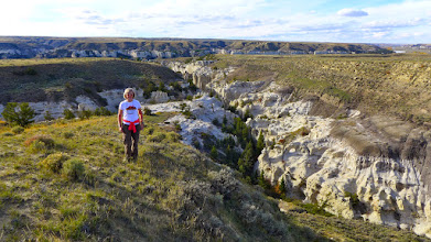 Photo: We came up through the canyon to Kelli's right and went back through the canyon on her left. The river can be seen in the background.