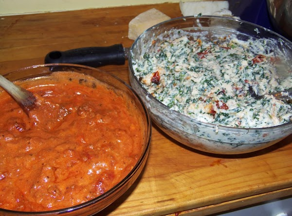 preheat oven to 350 degrees. Fill the manicotti shells with the ricotta mixture. I...