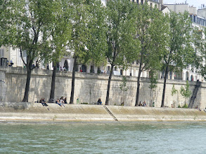 Photo: The Seine banks are crowded with strollers and picnickers on a pleasant Friday afternoon.