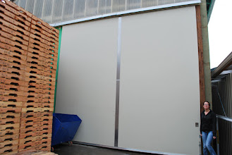 Photo: These large doors have a patented torsion box foam core that will keep them lightweight and smooth rolling!