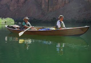 Photo: Ron M. escorts Mindly down the emerald waters.