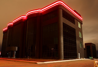 Photo: Our new HQ at night with the red LED band lit up for first time.