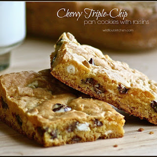 Chewy Triple-Chip Pan Cookies with Raisins.