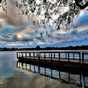 The Dock by Kathy Woods Booth - Landscapes Waterscapes ( calm, pier, waterscape, reflections, clouds, dock, serene, mirrored reflections )