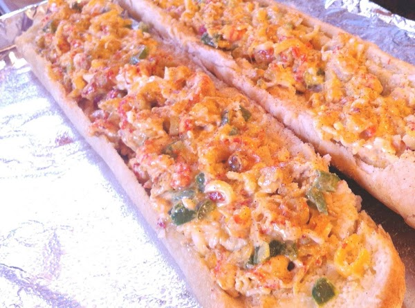Spread crawfish mixture inside the bread then put halves back together.