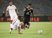 Vincent Pule of Orlando Pirates challenges Lelethu Skelem of Stellenbosch FC during the DStv Premiership match between Orlando Pirates and Stellenbosch FC at Orlando Stadium on October 28, 2020 in Johannesburg, South Africa.