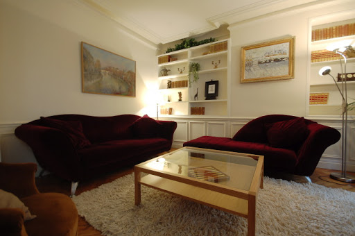 Bright living room at Rue Jean du Bellay Apartments