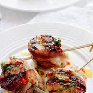 Bacon-Wrapped Scallops with Lemon-Herb Dressing.