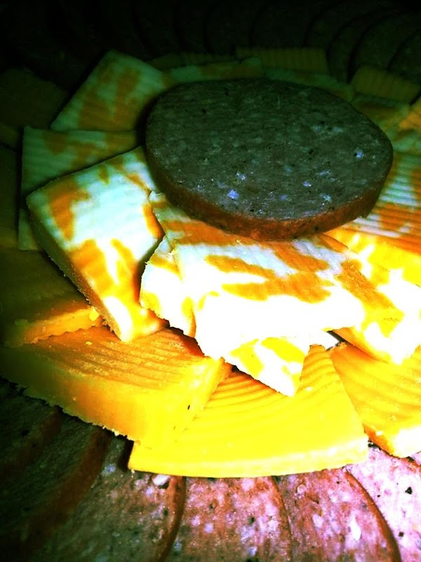 Slice meat and cheese into desired shapes and arrange on a plate or platter.