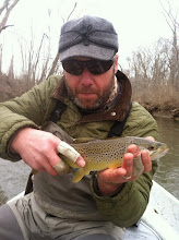 Photo: Scott Smallwood on the Mad.....more hand than fish...but a nice one regardless.