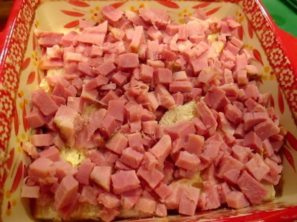 In an 8 inch greased baking dish or pan, place 4 slices ( crust...