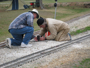 Photo: Bill Howe and Ken Smith working signals, a wire was crossed giving all red.  HALS 2009-0228