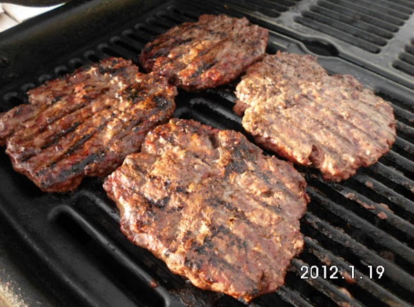 Season and grill burgers to your liking.