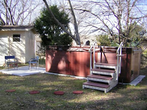 Photo: Here's a photo of my yard. I have THREE EZ pads: there are TWO 8 X8 pads supporting my Master Spa cross trainer and a THIRD that is my portable patio. I can move it to catch the sun or shade, depending on the time of year! My mantra: no more concrete! Great product!  Gail C. Dallas, TX