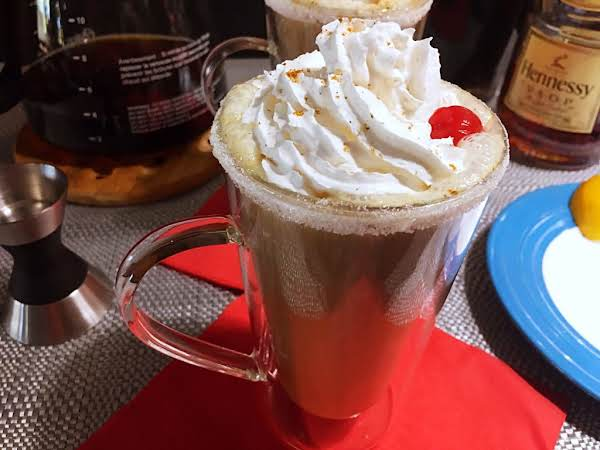 A Coffee Topped With Whipped Cream And Cherry.