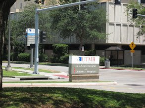 Photo: University of Texas Branch - campus sign on Market Street, Galveston