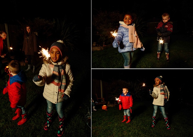 Kids play with sparklers on Bonfire Night
