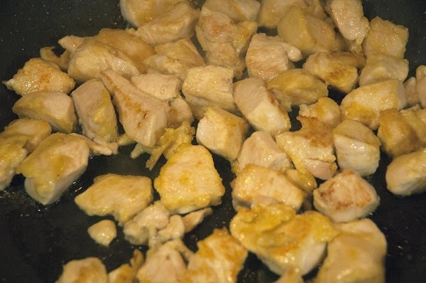 Cook until the chicken is cooked through and beginning to brown.
