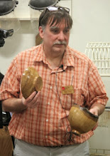 """Photo: Tim Aley shows two footed bowls he made from the Tudor Place oak -- one natural-edge and one """"regular""""."""
