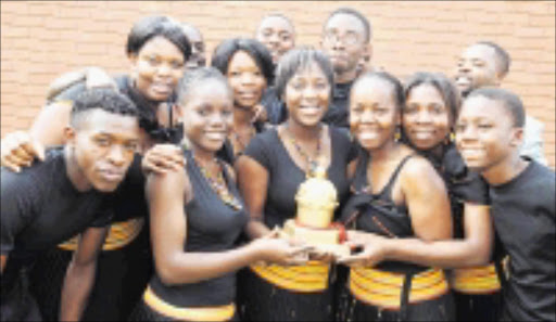 WINNERS: Worshio House Band members with the crown they won at the Crown Gospel Musical Awards in Durban in August. Pic. Elijar Mushiana. 09/09/2008. © Sowetan