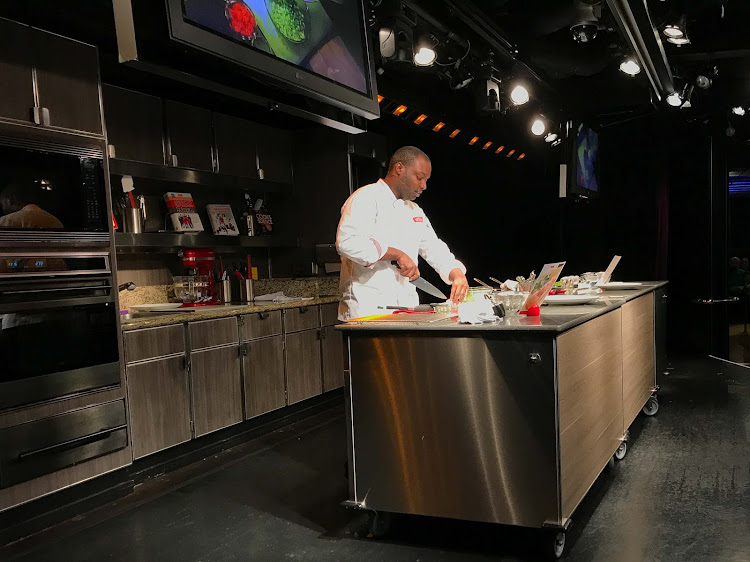 A cooking demonstration in America's Test Kitchen on ms Oosterdam.